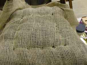 Picture of stripped chair being covered in scrim